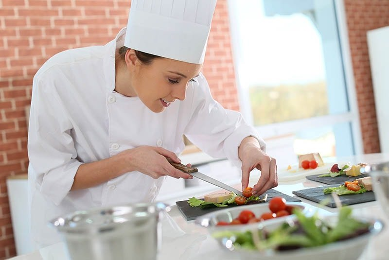 chef preparing food as part of food safety management system and 7 principles of HACCP